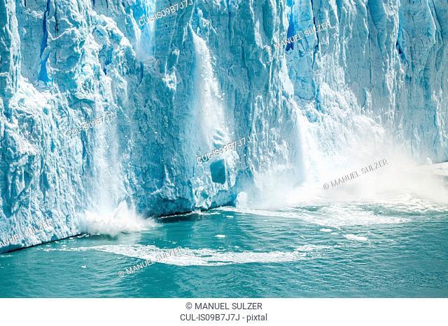 Ice from Perito Moreno Glacier falling into Lake Argentino, Los Glaciares National Park, Patagonia, Chile