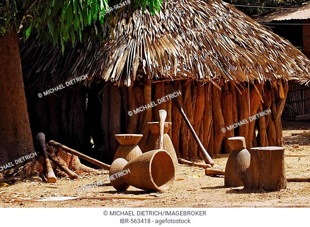African hut with equipment for mashing cassava, Tunami Tenda, The Gambia, Africa
