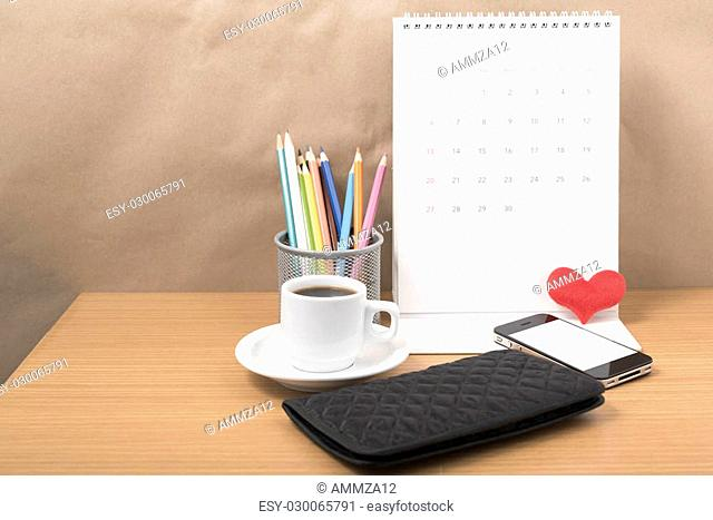 office desk : coffee with phone,wallet,calendar,heart,color pencil box on wood background