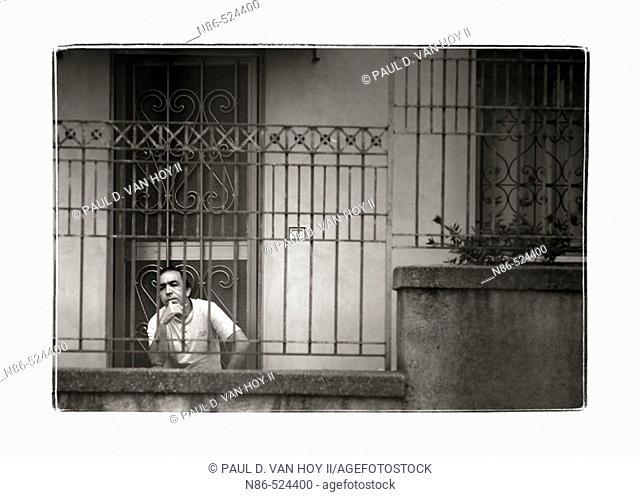 Sicilian man on porch smoking