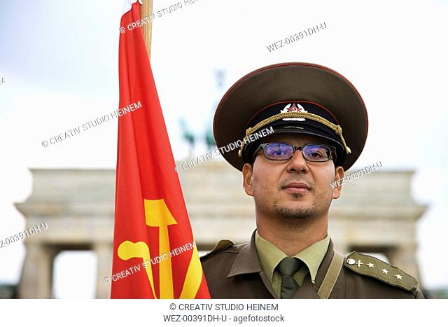 Germany, Berlin, Russian soldier in front of Brandenburger Tor, portrait