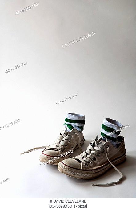 Pair of training shoes and socks, studio shot
