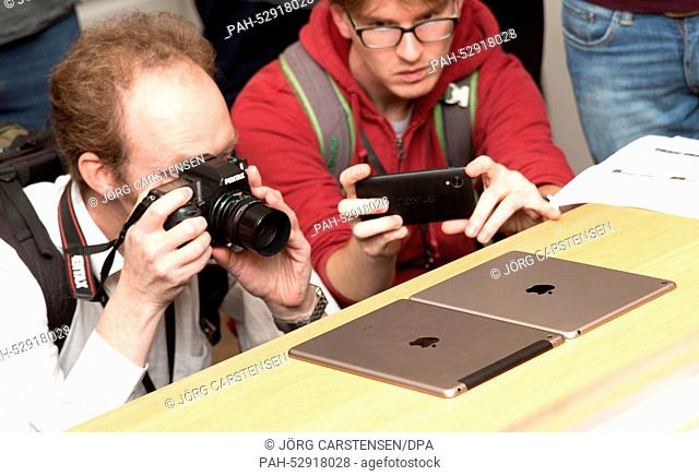 Visitors take photos of the new iPad Air 2 which was introduced on the same day at the Apple store in Berlin, Germany, 16 Ocotober 2014
