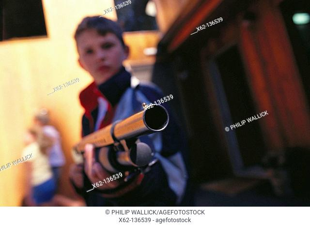 Boy with shotgun