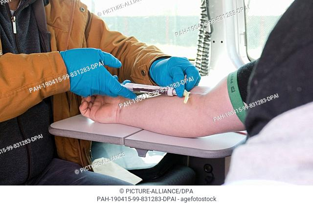 15 April 2019, Lower Saxony, Hannover: A doctor takes a blood sample from the Polish driver of a van at a rest stop on the A2 motorway after the urine sample...
