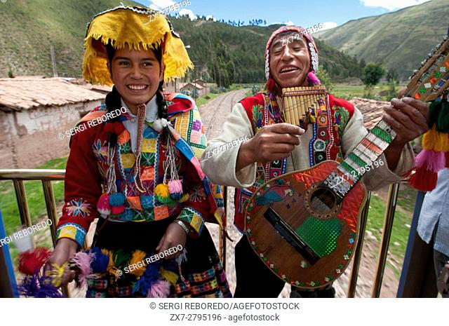 Andean Explorer, luxury train from Cusco to Puno. Train inside. Musicians and dancers in traditional costumes dancing enliven the journey with passengers in the...