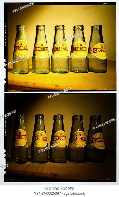 Tilburg, Netherlands. Crodino Bottles on Analog, Positive Flat Film, captured using an LED Light Box and an Smartphone Camera