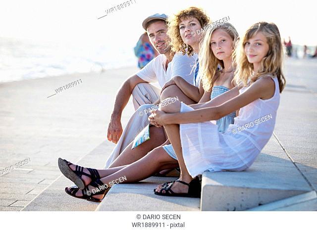 Family on boardwalk, looking at camera, Zadar, Croatia