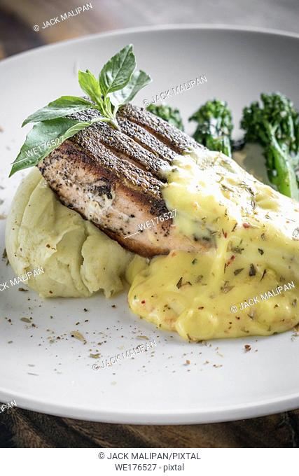 grilled salmon fish fillet with mashed potato and dijon mustard cream sauce