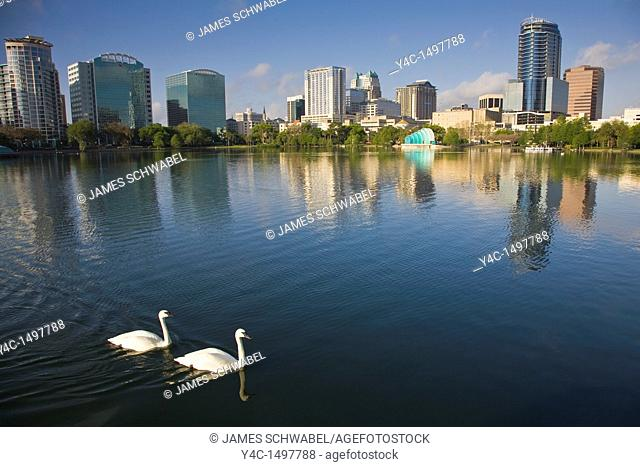 Modern architecture skyline of Orlando Florida reflects in Lake Eola