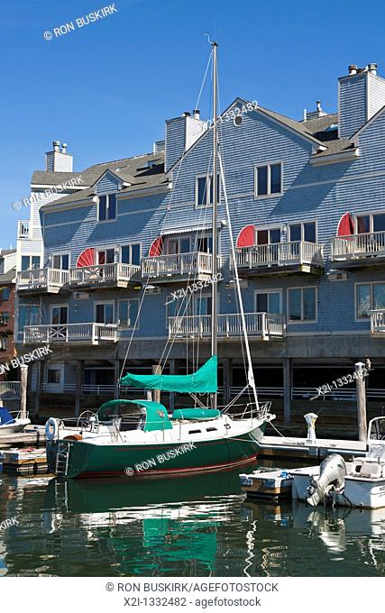 Sailboat docked at condominium in the Old Port area of Portland, Maine