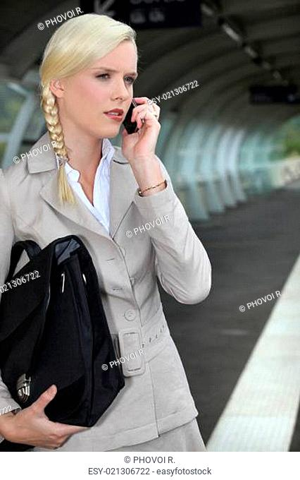 Businesswoman waiting for a train