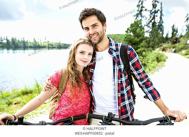 Young couple doing a bicycle trip