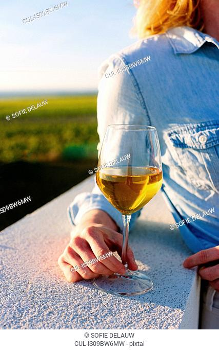 Woman with glass of Marsala wine, Marsala, Sicily