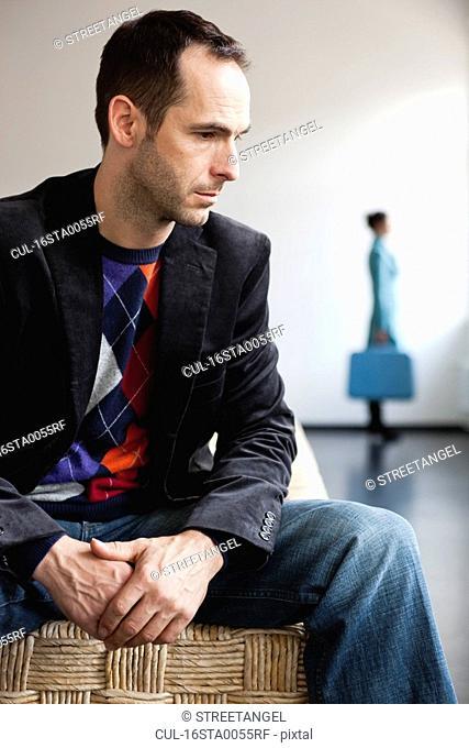 man sitting on basket