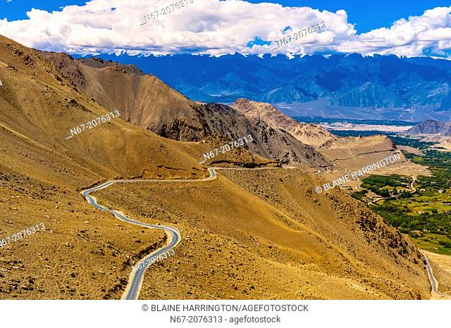Road leading to Khardungla Pass. At 18,379 feet, the pass is the highest motorable road in the world. Ladakh, Jammu and Kashmir State, India