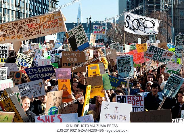 February 15, 2019 - London, England, United Kingdom - Thousands of young people gather in Parliament Square in central London to protest against the...