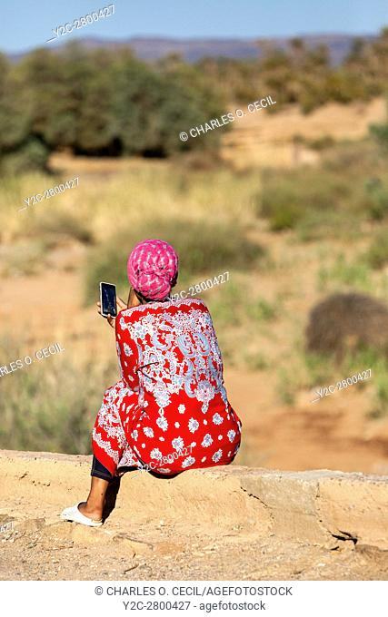 Elkhorbat, Morocco. Young Berber Woman Using her Cell Phone