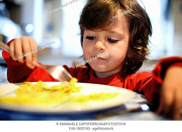 Child eat pancake breakfast