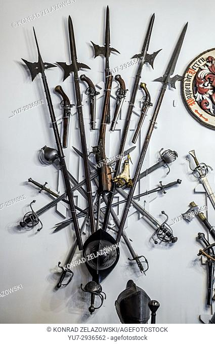 Mediaeval weapons on the wall of Grand Armory Hall in Peles Palace, former royal castle, built between 1873 and 1914 near Sinaia city in Romania