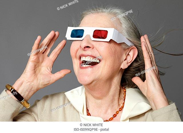 Senior woman wearing 3d glasses