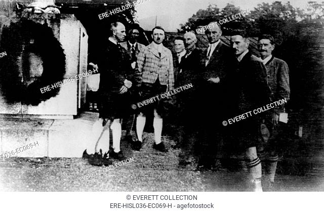 Adolf Hitler with seven men at wreathed monument, ca. 1920. (BSLOC-2013-9-151)