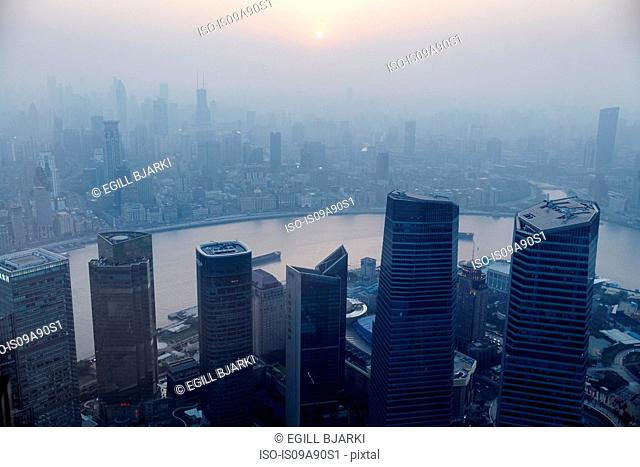 High angle view of misty cityscape, Shanghai, China