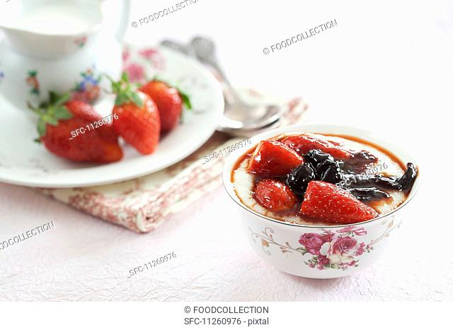 Porridge with berries in a floral coffee cup