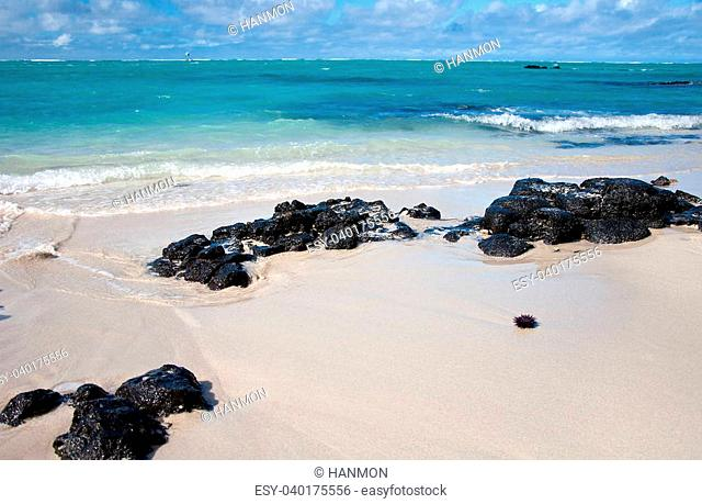 Beautiful beach with lava stones on Ile aux Cerfs