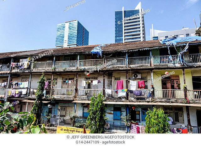 India, Asian, Mumbai, Lower Parel, old, older, apartment building, residences, balconies, hanging, laundry, clothes, new modern skyscrapers