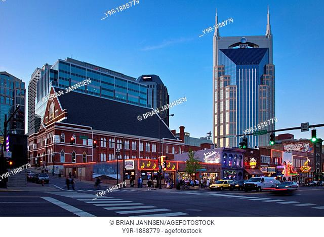 The AT&T building towers over the Ryman Auditorium, historic bars and honky-tonks along Broadway in Nashville Tennessee USA