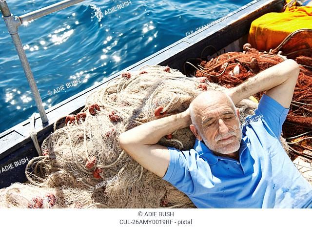 Fisherman asleep on nets