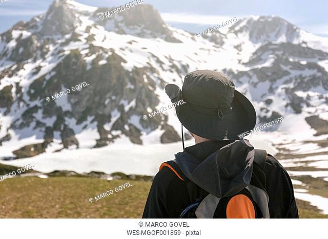 Spain, Asturias, Somiedo, man hiking in mountains