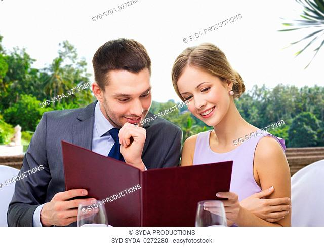 couple with menu at restaurant