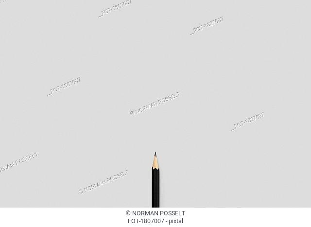 Sharpened pencil against white background