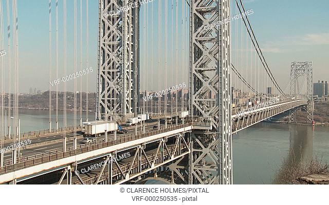Timelapse sequence of afternoon traffic flowing over the George Washington Bridge high over the Hudson River, as viewed from Fort Lee, New Jersey