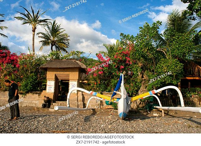 A boat rests on the sandy beach of Amed, a fisherman village in East Bali. Amed is a long coastal strip of fishing villages in East Bali