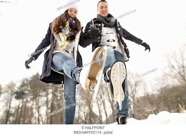 Couple ice skating on a frozen lake