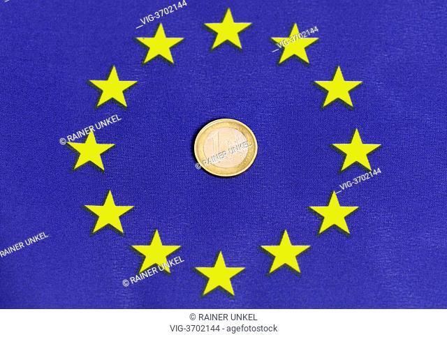 GERMANY, BONN, 20.05.2013, A flag of EU and a one Euro coin - Bonn, Northrhine-, Germany, 20/05/2013
