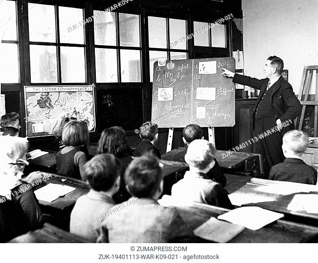Nov. 13, 1940 - London, England, U.K. - London kiddies evacuated to a little Welsh village are attending the village school