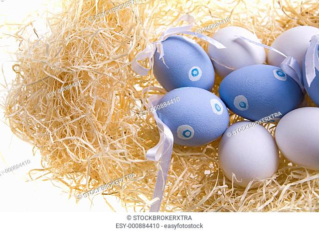 Photo of several Easter eggs decorated with ribbons