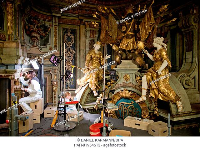 Conservator-restorers Patricia Dornstädter (l) and Jan Bruenner pictured during restoration work on the Margravial Opera House in Bayreuth, Germany, 24 May 2016