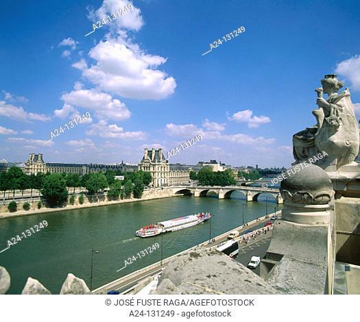 Seine River, Louvre Museum in background. Paris. France