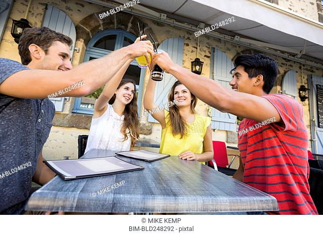 Friends toasting at restaurant