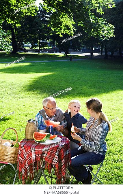 Senior man woman and girl having a picnic Sweden