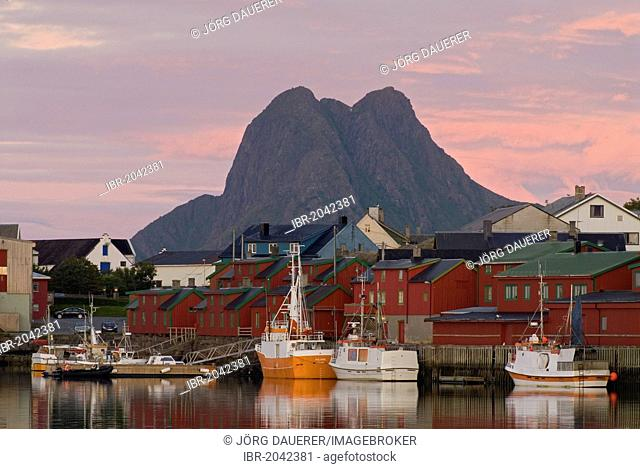 The peaks of Vestvågøy behind the boats and houses of Stamsund, Nordland, Norway, Europe