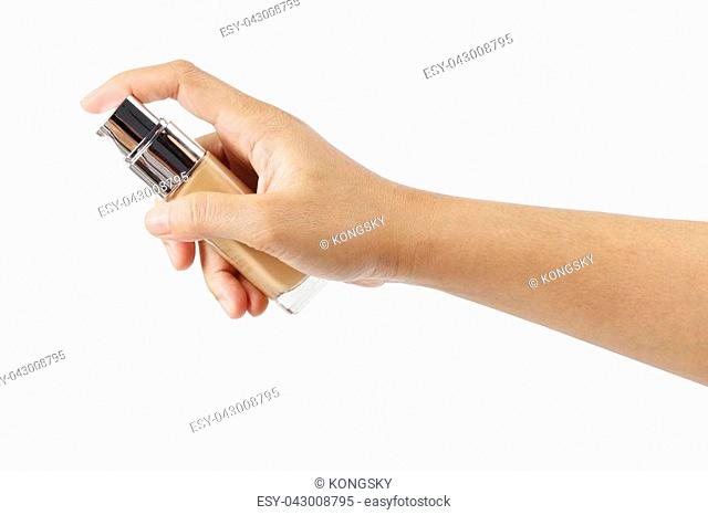 Woman's hand with liquid foundation isolated on white background, clipping path