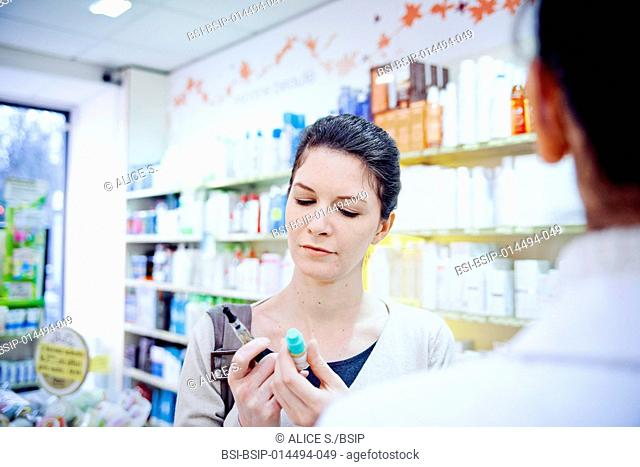 Woman buying an e-cigarette in a pharmacy