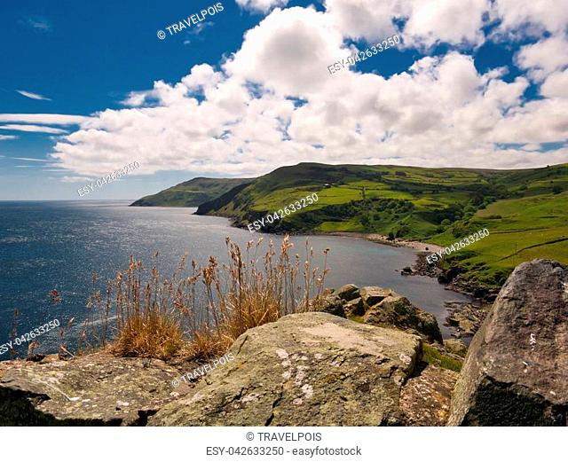 View from the historic Torr Head in Northern Ireland heading to the south with sunshine and light clouds