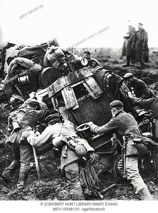 Austro-Hungarian troops trying to dislodge heavy equipment out of the mud during their advance through Romania, on the Eastern Front, during the First World War